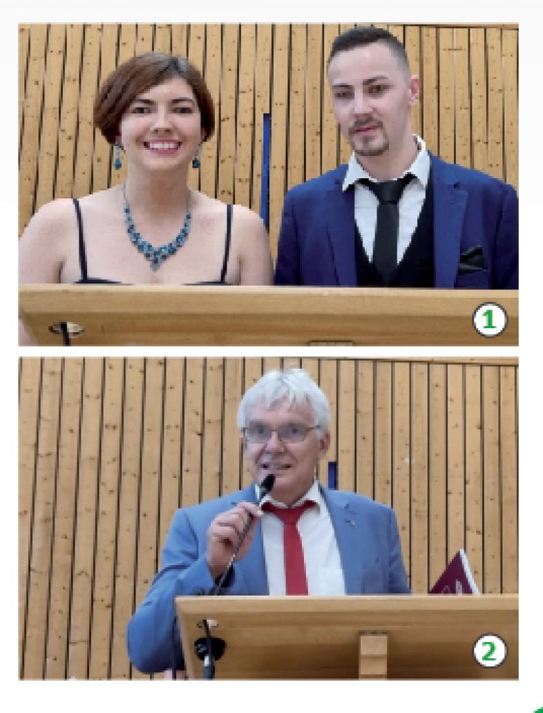 Die Moderator*innen und Claus Duncker - wie im Text beschrieben am Rednerpult