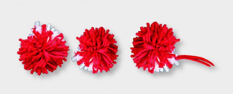 Foto von drei rotweißen Bommeln nebeneinander